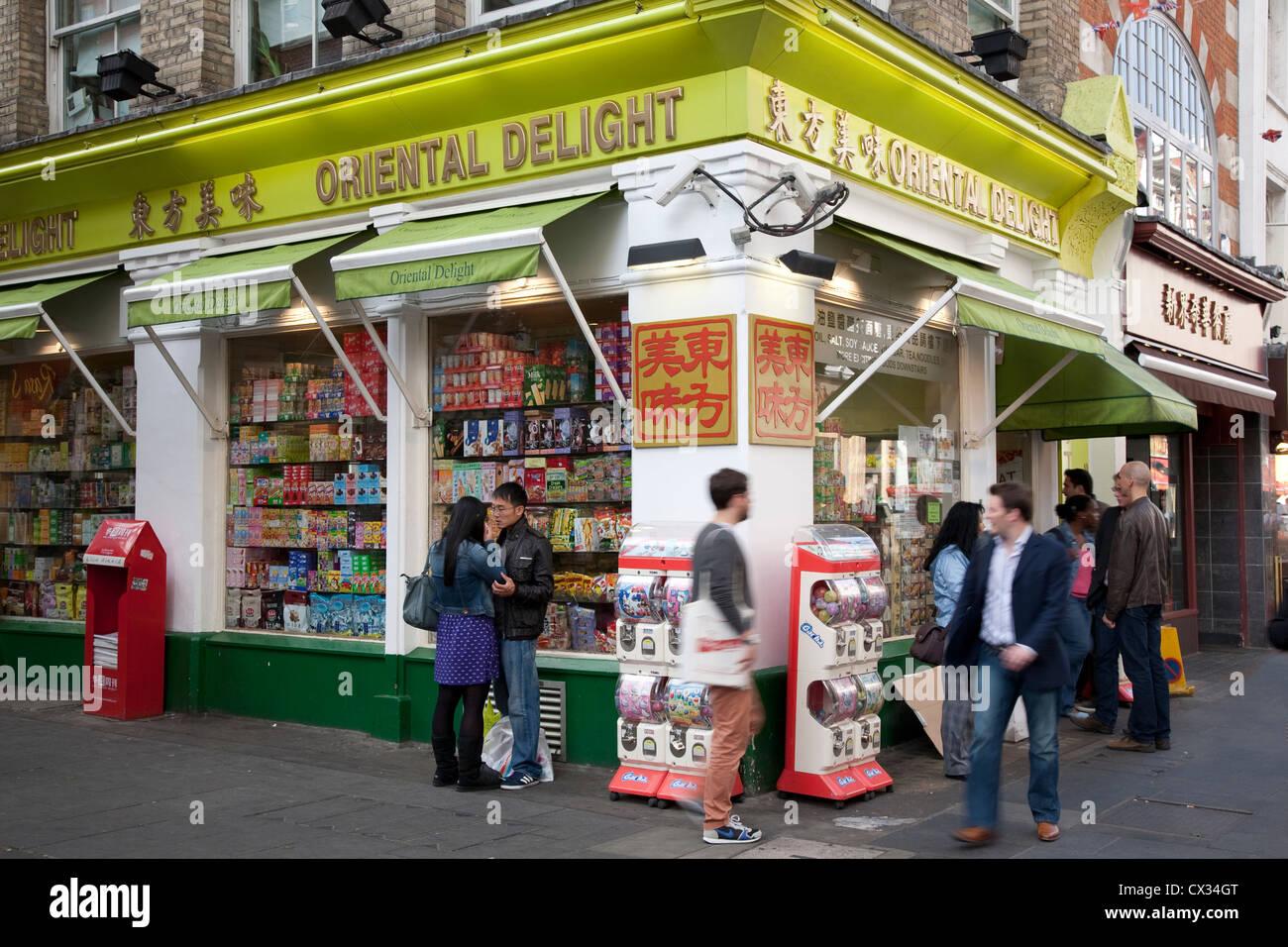 People outside Oriental Delight Shop, Soho, China Town, London, England, UK - Stock Image