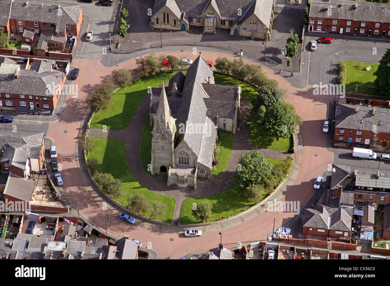 aerial view of a church in a roundabout on a housing estate in Oldham - Stock Image