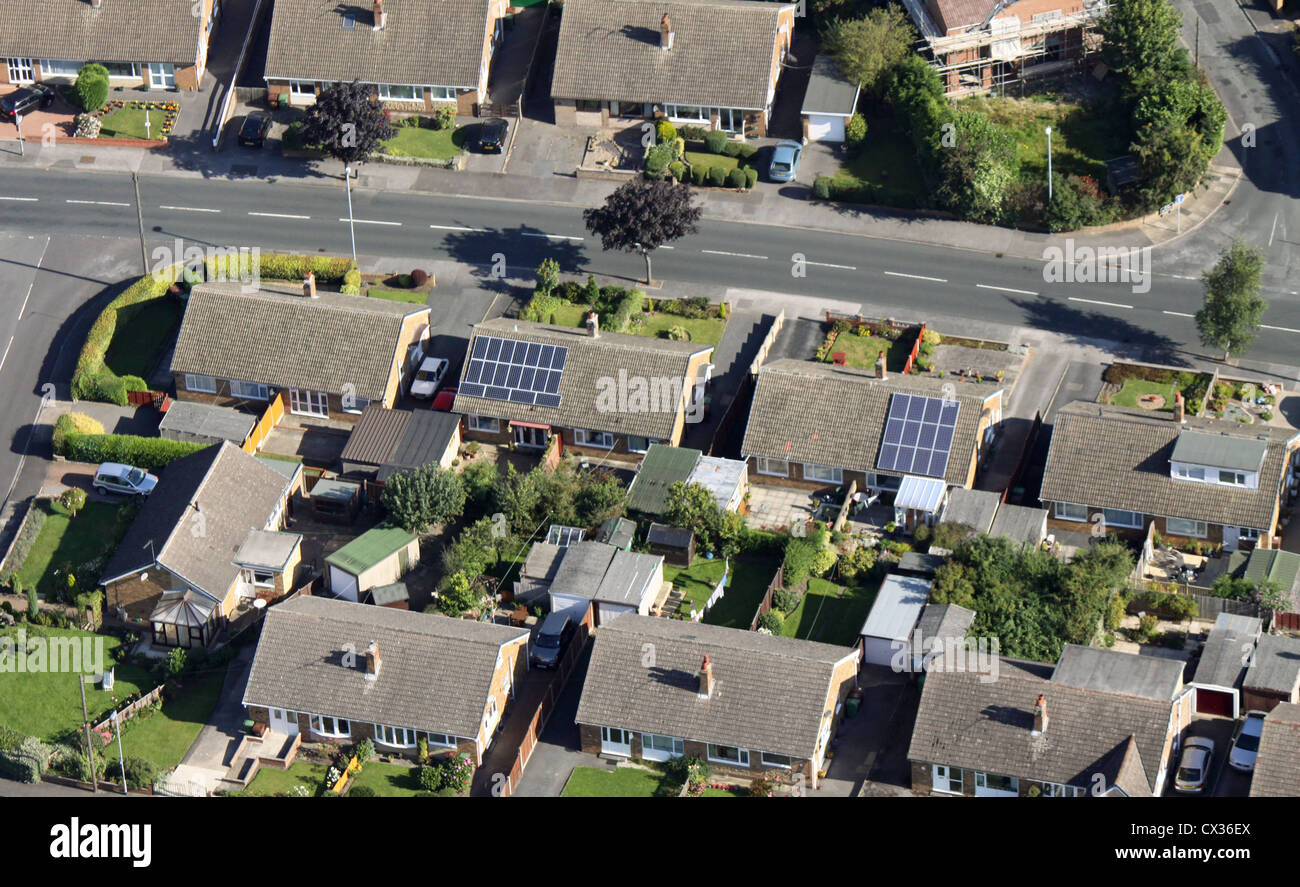aerial view of domestic solar panels on a private house roof - Stock Image