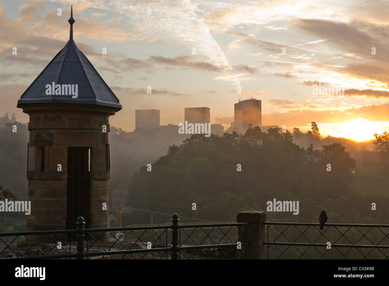 Luxembourg City - View from the old town with a spanish tower at the scyscrapers of Kirchberg at sunrise. Stock Photo