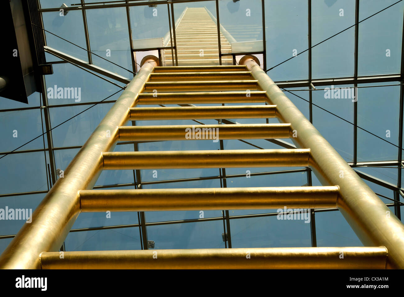 golden ladder of the Forum shopping complex in Duisburg, North Rhine-Westphalia, Germany, Europe - Stock Image