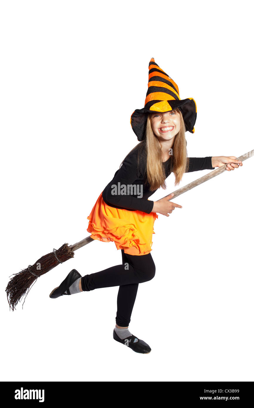 little witch flying with her broom on white background - Stock Image
