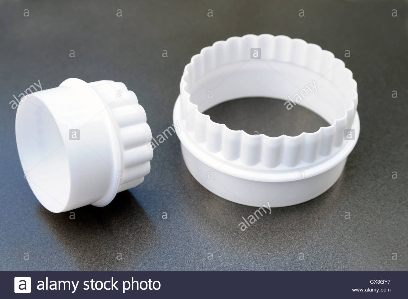 Pastry cutters. White plastic cookie cutter set. Stock Photo