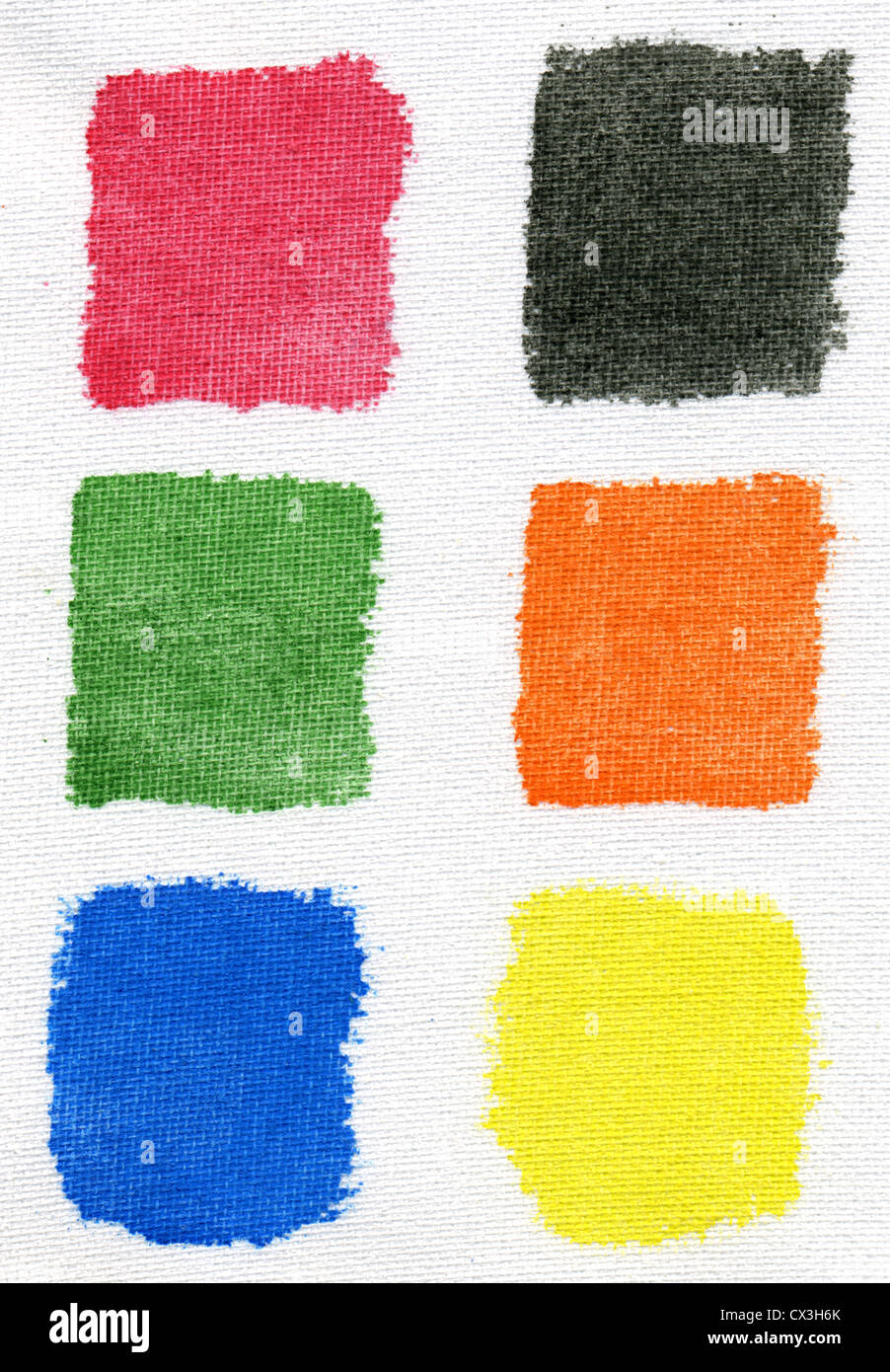 Testing watercolor paints on an artists canvas. - Stock Image