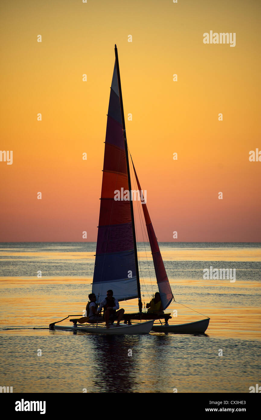 Sunset Sail boat on Cape Cod Bay, Massachusetts, USA - Stock Image