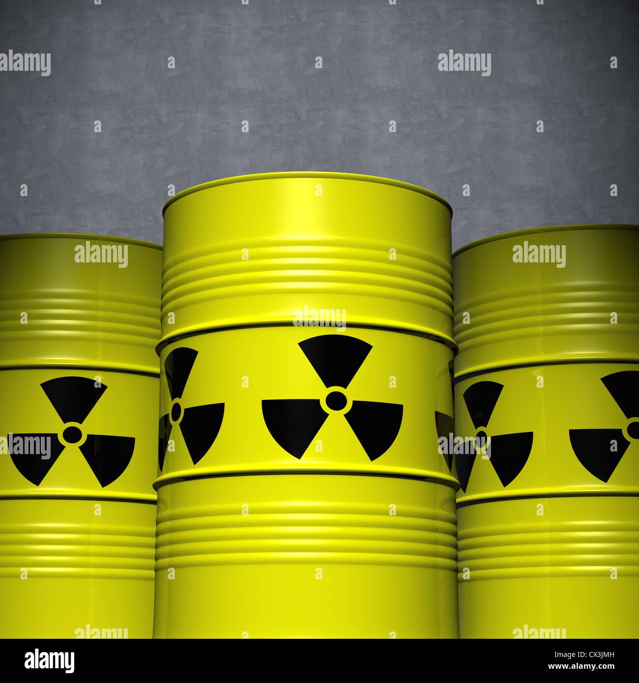 3 Fässer mit Atommüll vor einer Betonwand - Three Clean Yellow Steel Barrels with Nuclear Waste Stock Photo