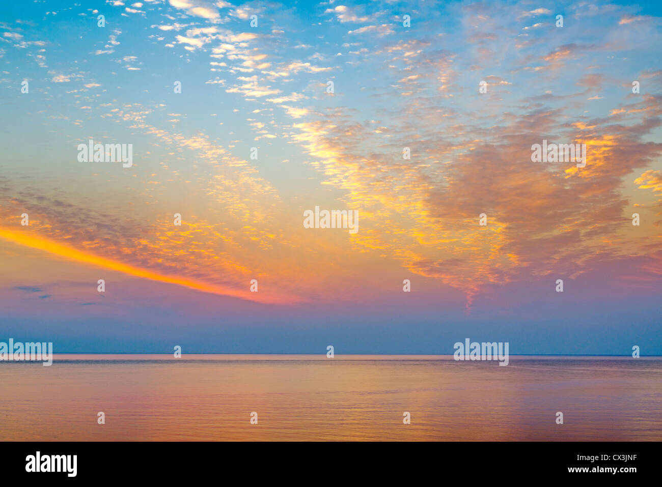 Sunrise over the ocean. - Stock Image