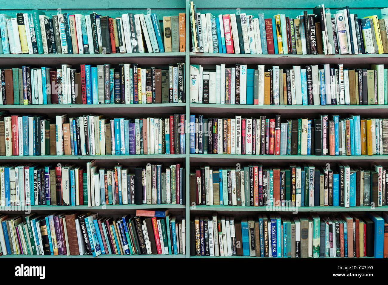 Books on a shelf. - Stock Image