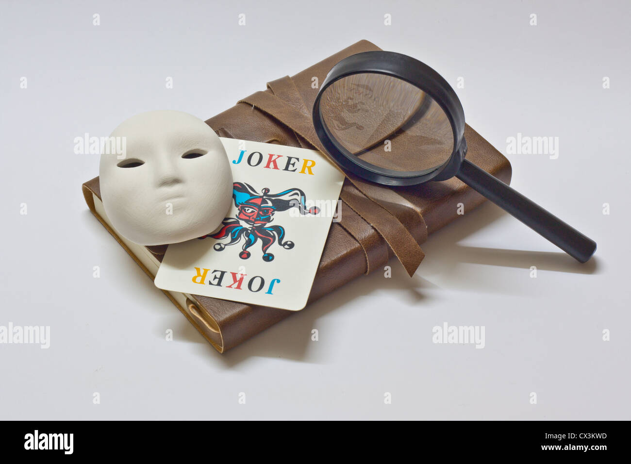 detective notebook and joker - Stock Image