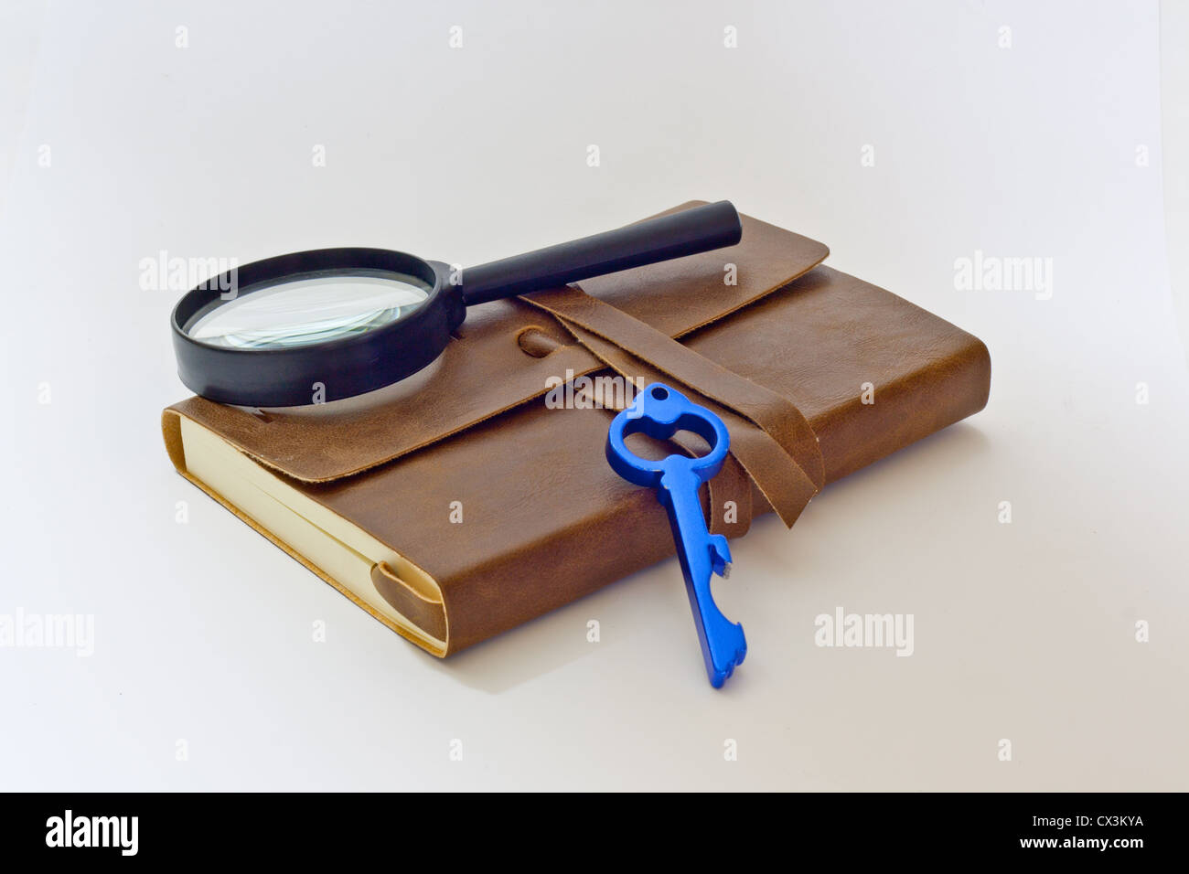 detective notebook and key - Stock Image