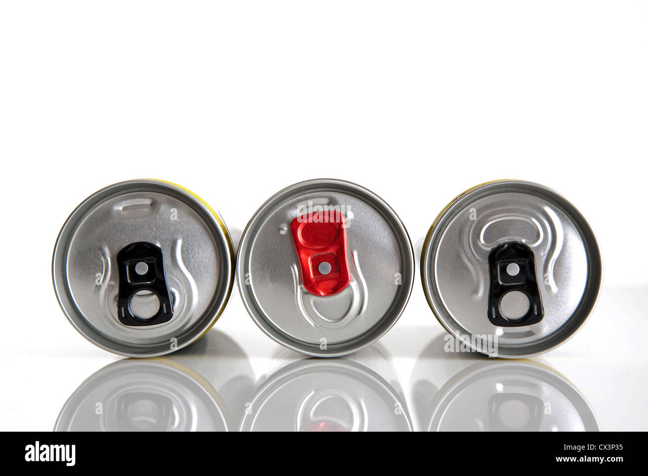 Three silver aluminum cans for drinks and their black and red rings opening - Stock Image