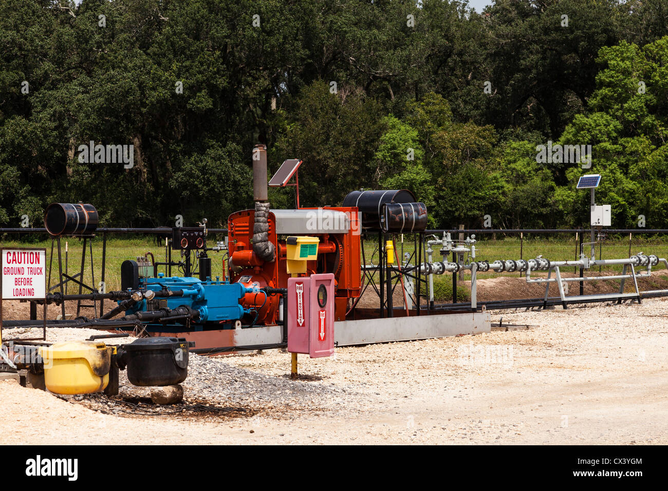 Pumping system for loading trucks at a remote crude oil well site. - Stock Image
