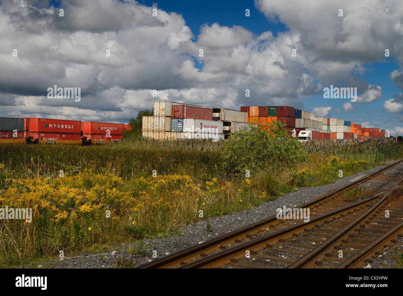 Intermodal transport containers stacked at a rail depot for delivery by truck Ontario Canada - Stock Image