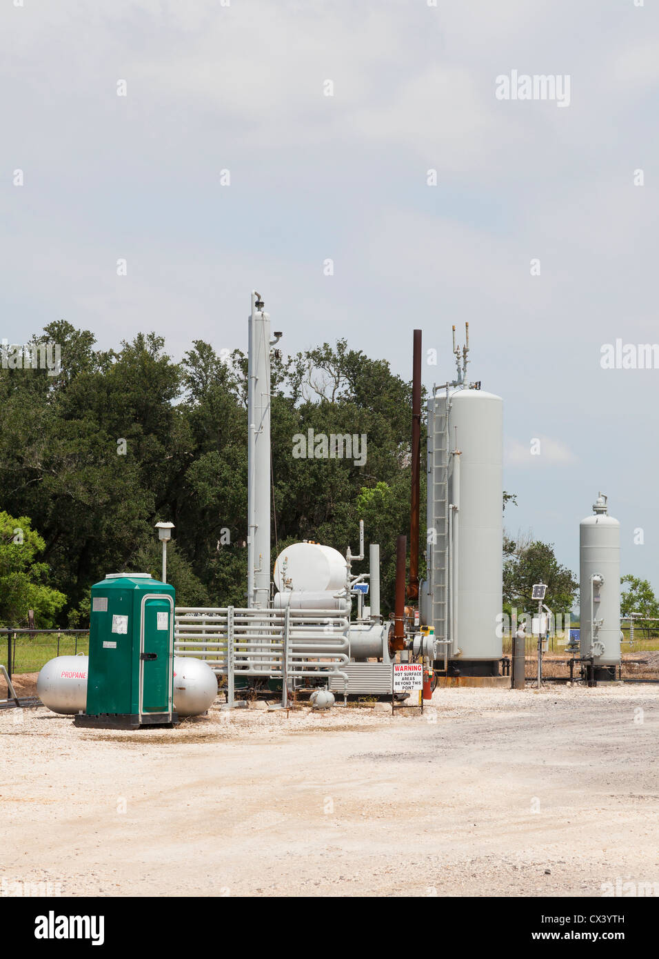 Remote crude oil pumping and truck loading facility for rural oil wells, showing flaring system - Stock Image