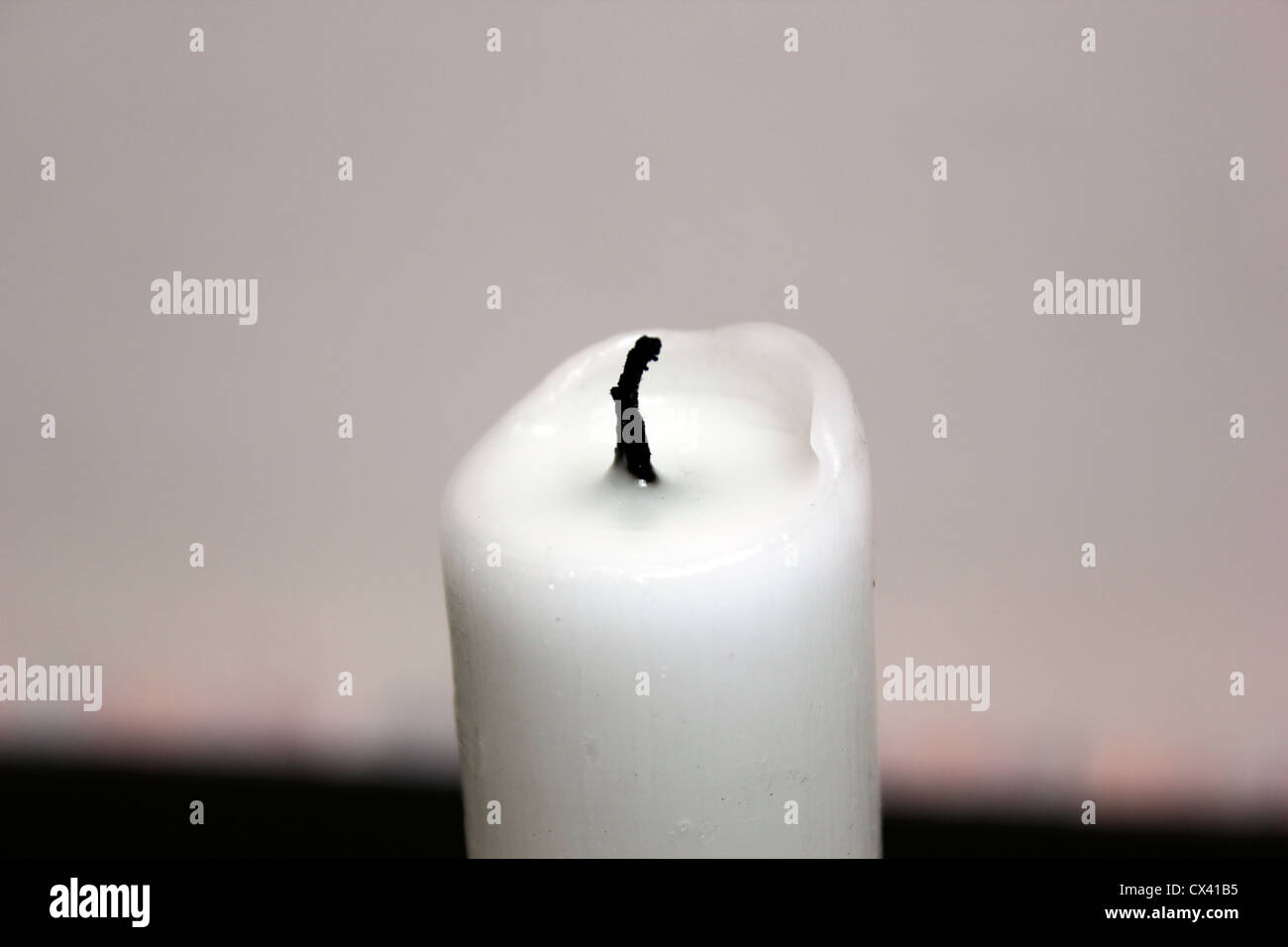 An unlit candle Stock Photo