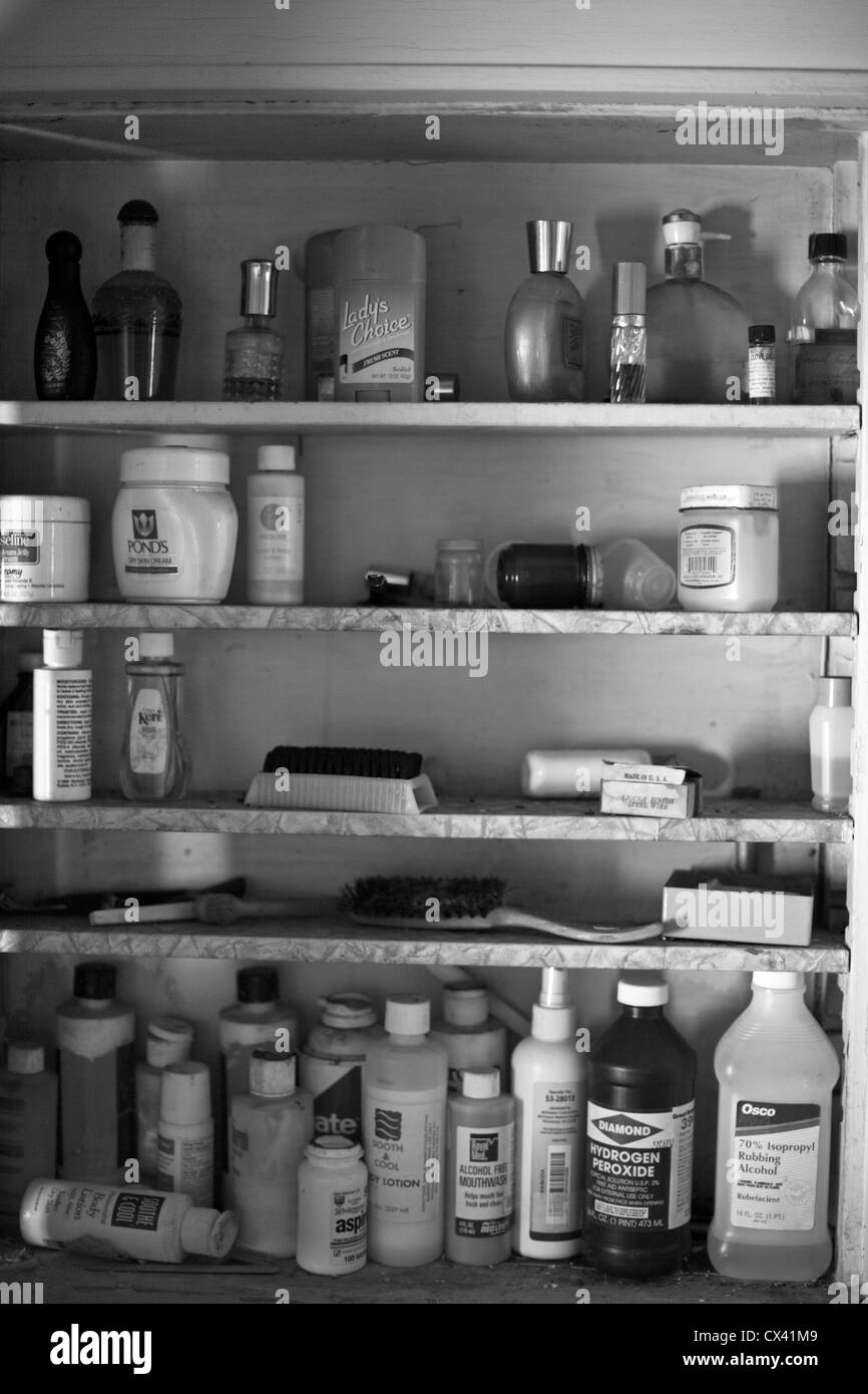 A house which has sat vacant for 20 years still has bottles in the medicine cabinet. - Stock Image