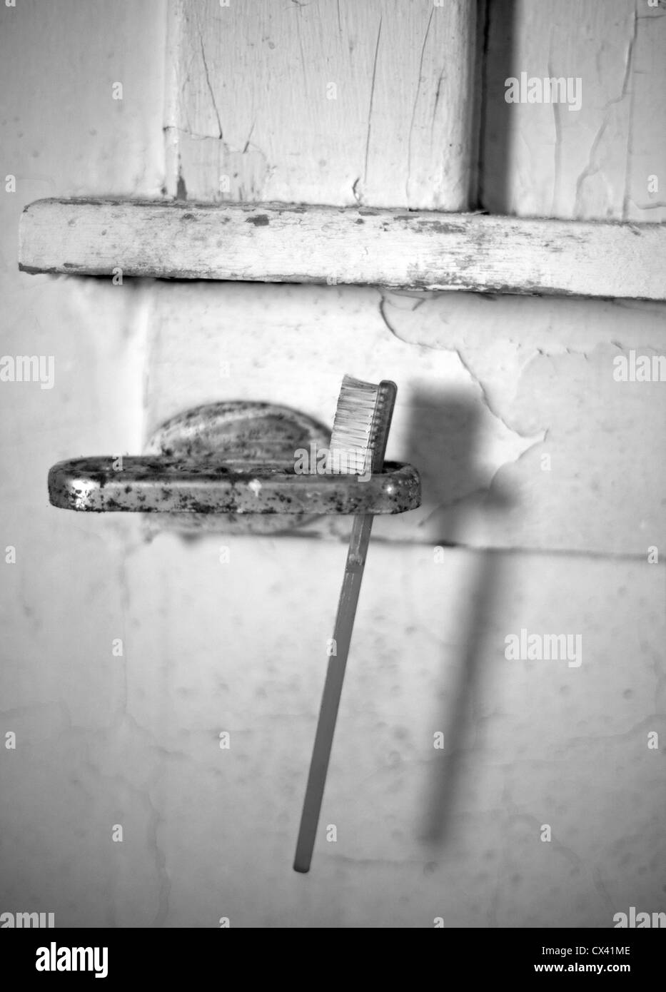 A house which has sat vacant for 20 years shows signs of neglect. - Stock Image
