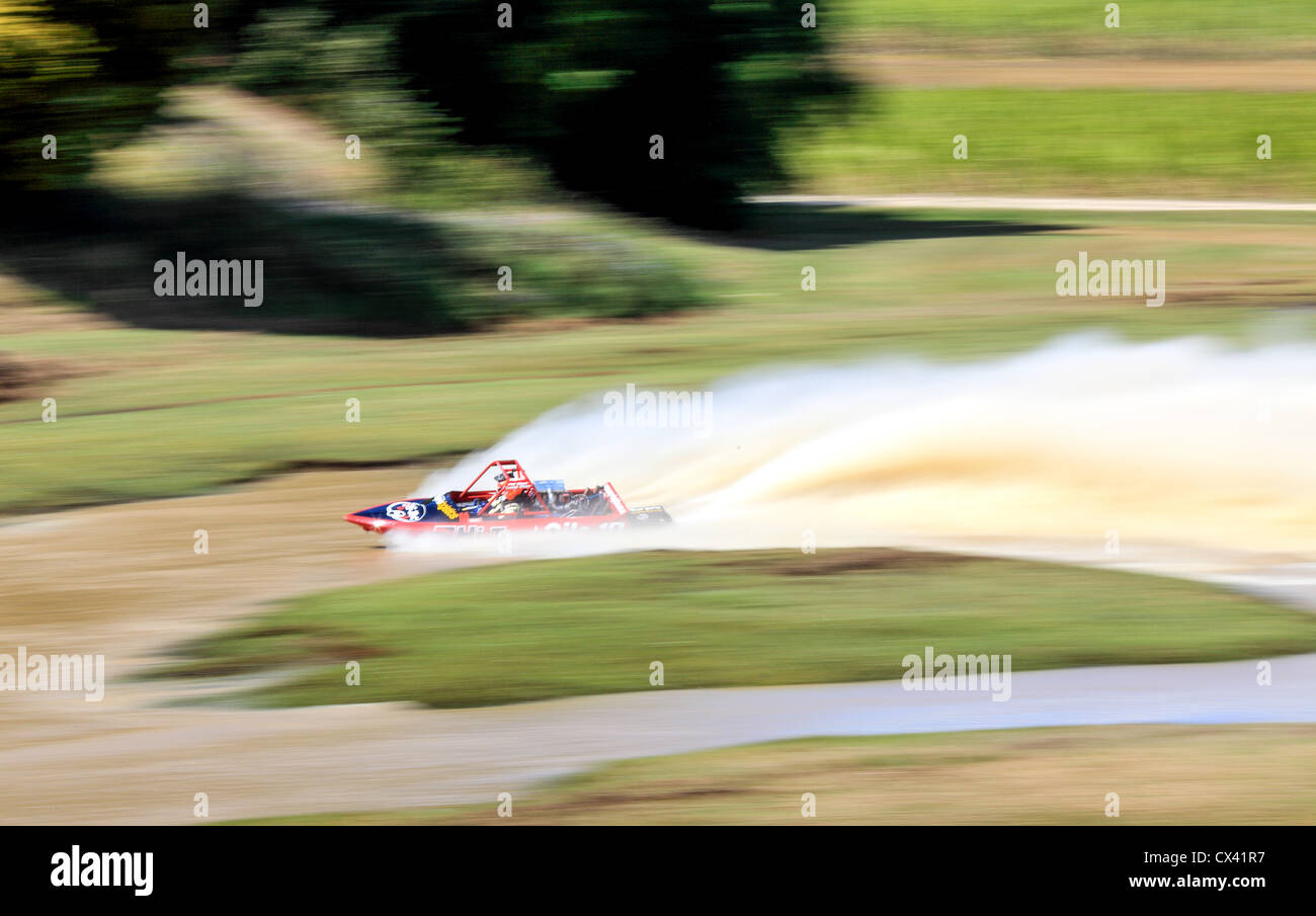 Motion blur of a boat at the Australian Jet Sprint Boat championship timed sprint runs enclosed course Cabarita - Stock Image