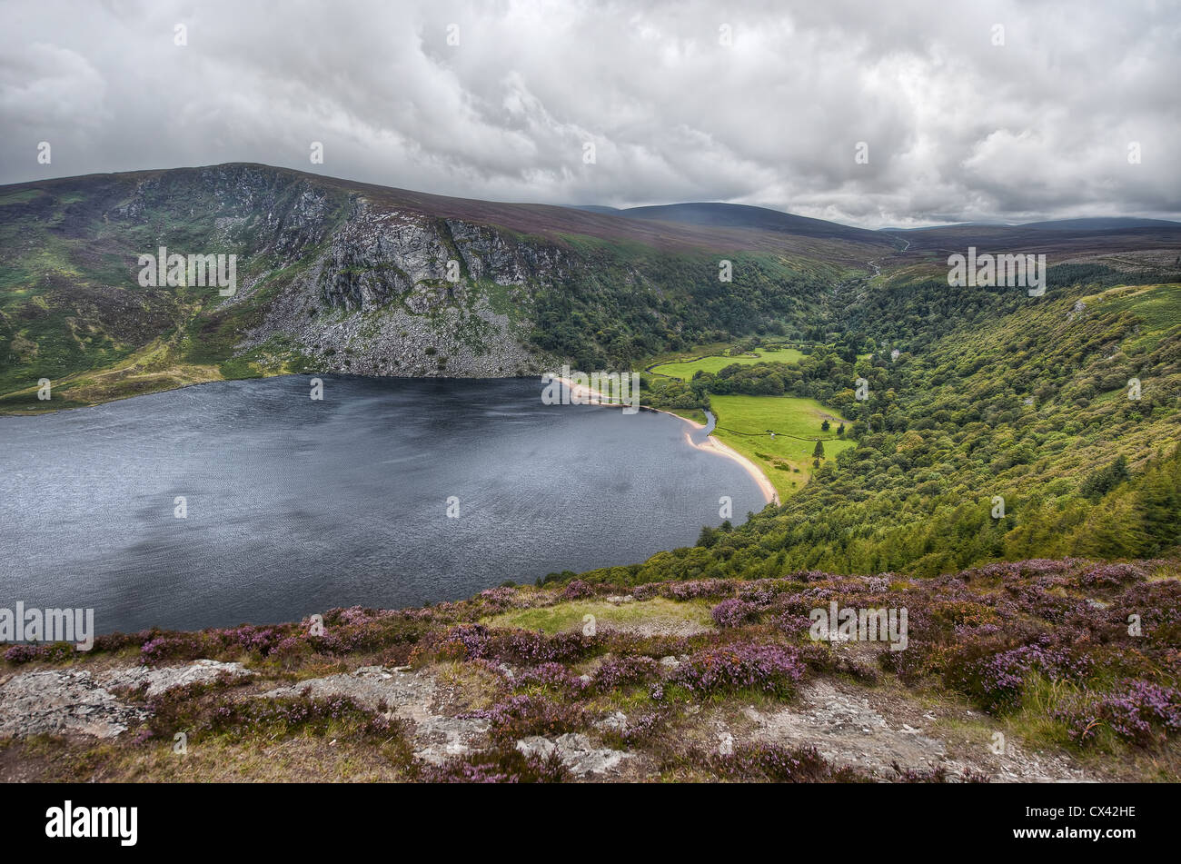 A cloudy day over the mystical Lough Tay in County Wicklow, Ireland - Stock Image