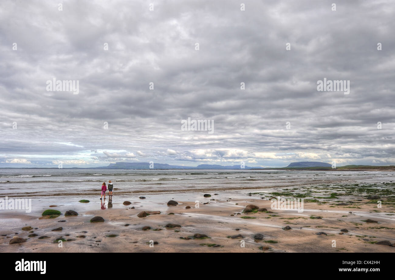 The beach at Dromore West in County Sligo, Ireland with views of Benbulben and Knocknaree in the distance - Stock Image