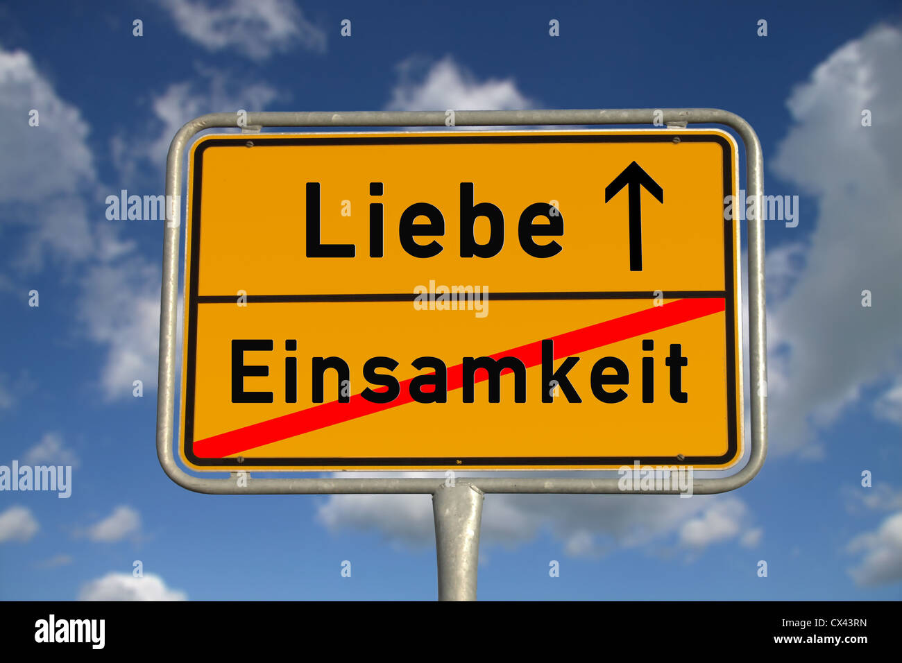 German road sign loneliness and love with blue sky and white clouds - Stock Image