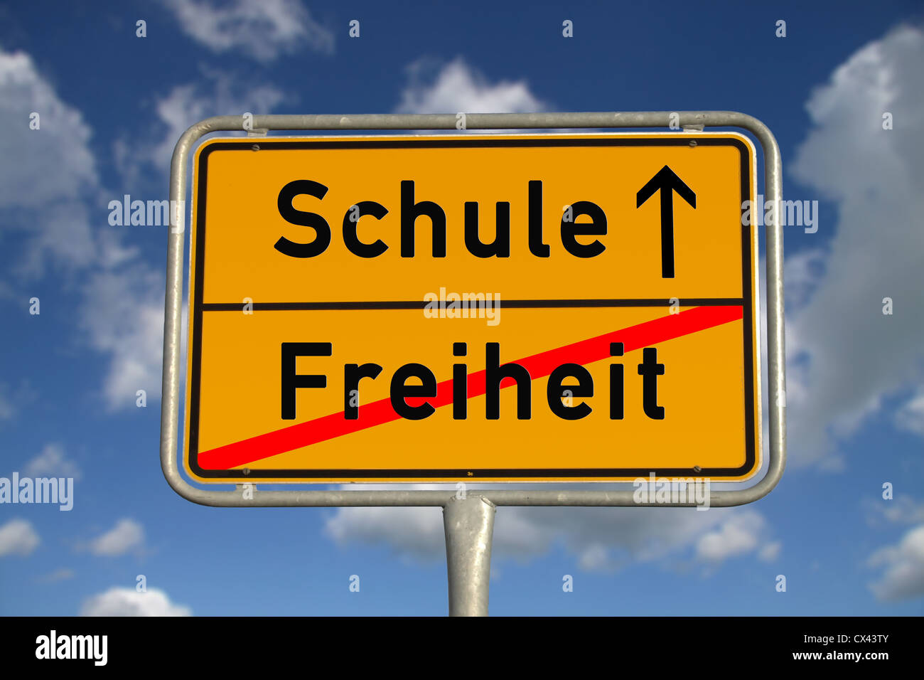 German road sign freedom and school with blue sky and white clouds Stock Photo