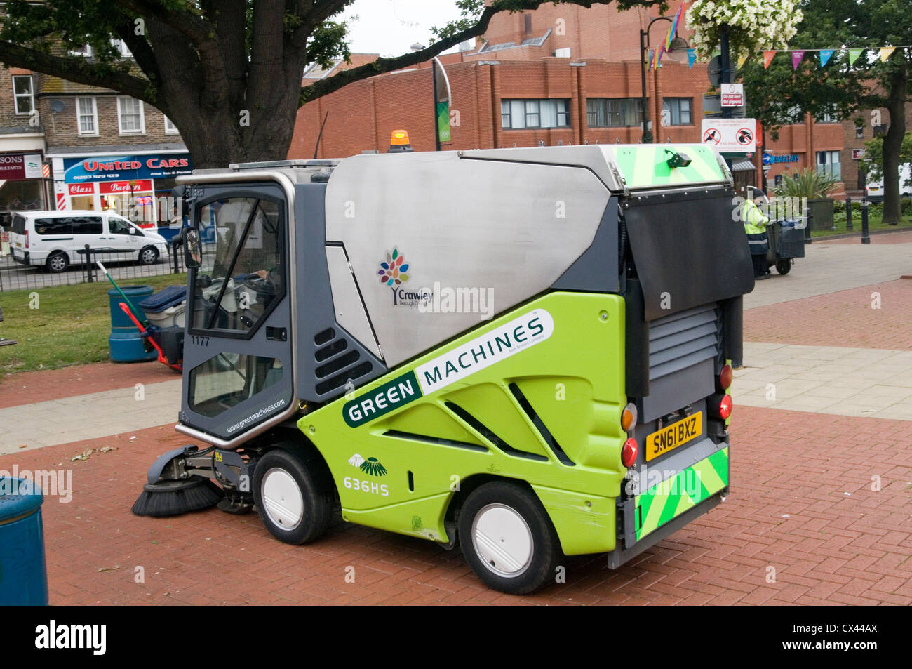 street cleaning cleaner cleaners sweep sweeping the streets public space cleaning services municipal road roadsweeper Stock Photo