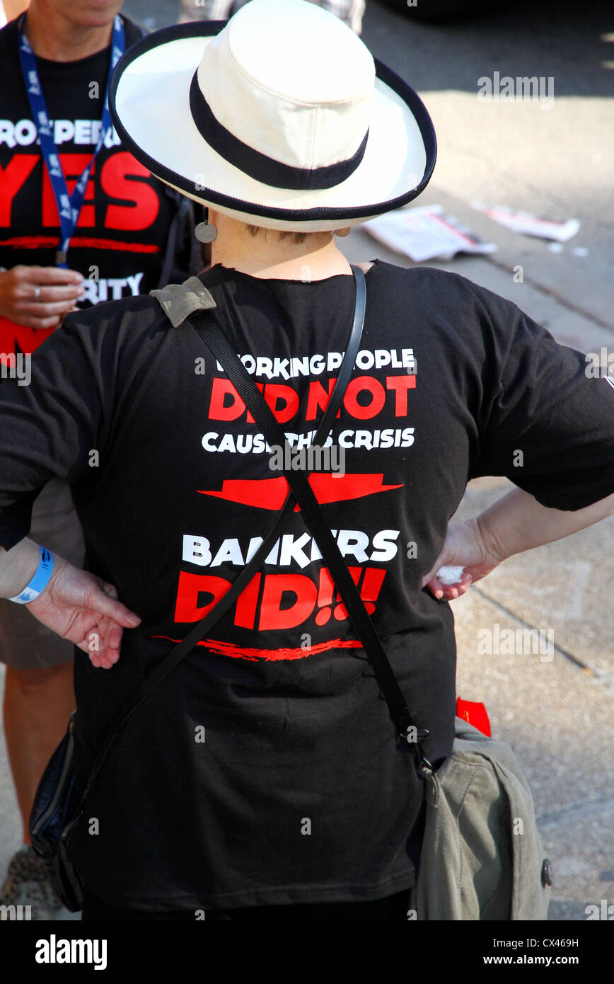 A woman wearing an anti-bankers t-shirt - Stock Image