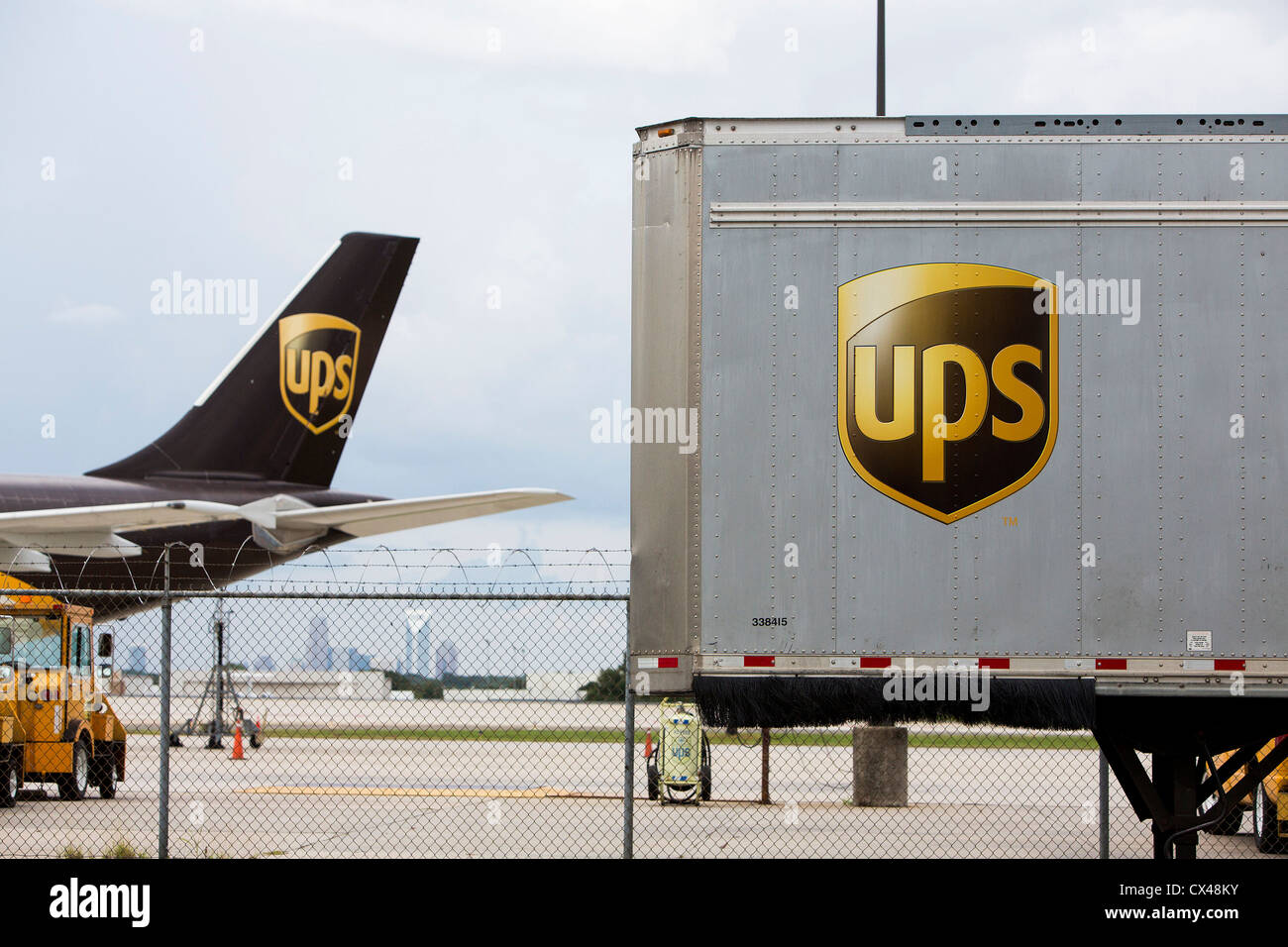 A United Parcel Service (UPS) cargo airplane outside of a sorting facility.  - Stock Image