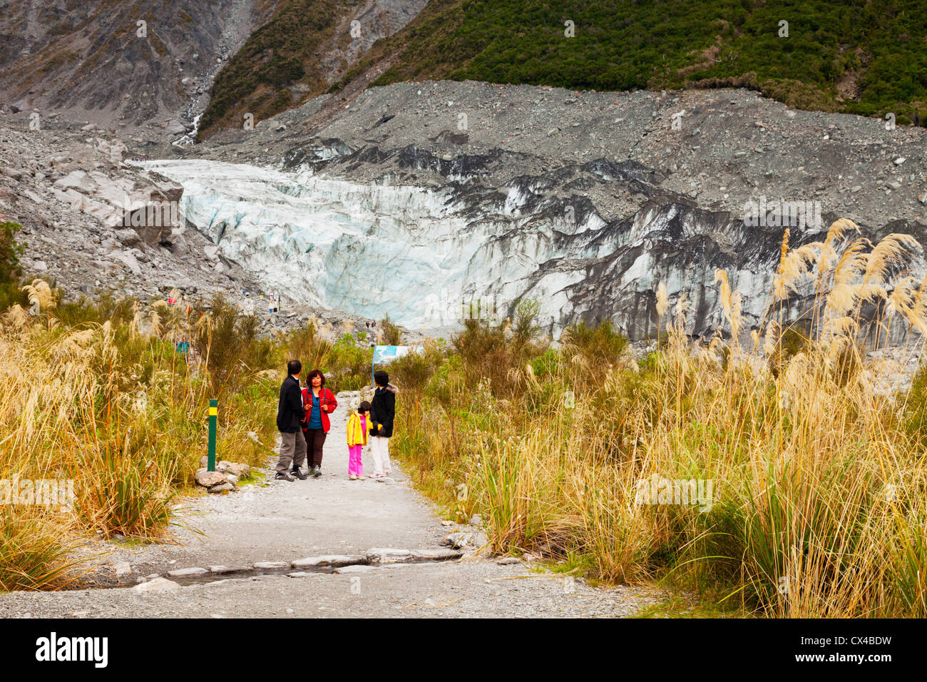 Group of tourists leaving the terminal of Fox Glacier, West Coast, New Zealand. - Stock Image