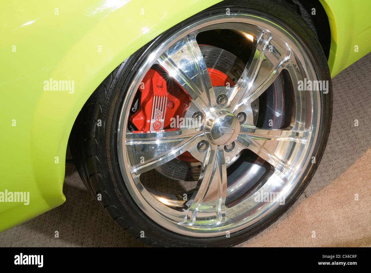 shiny polished alloy metal custom car wheel. - Stock Image