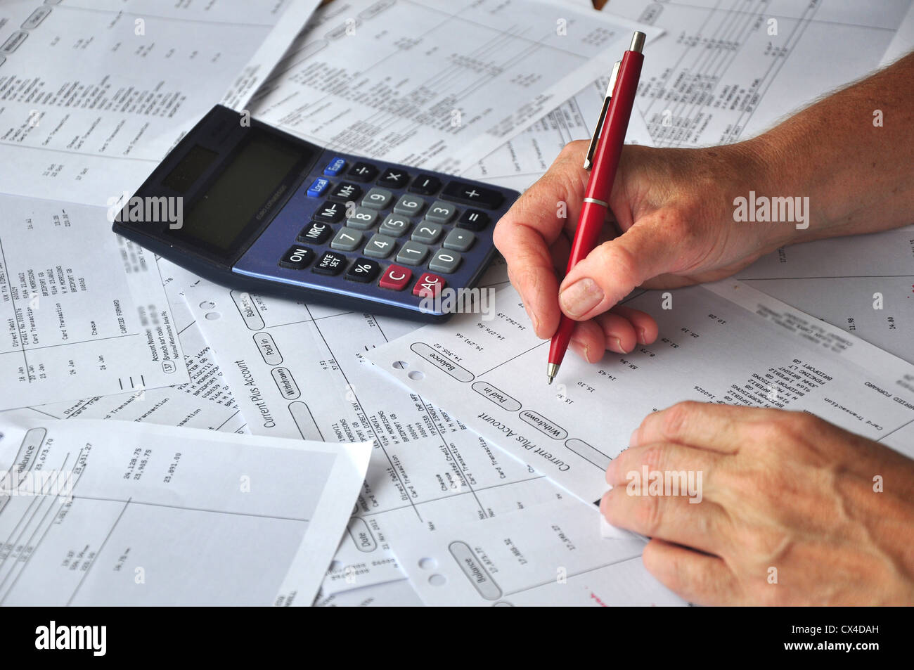 Sorting out the bank statements UK - Stock Image