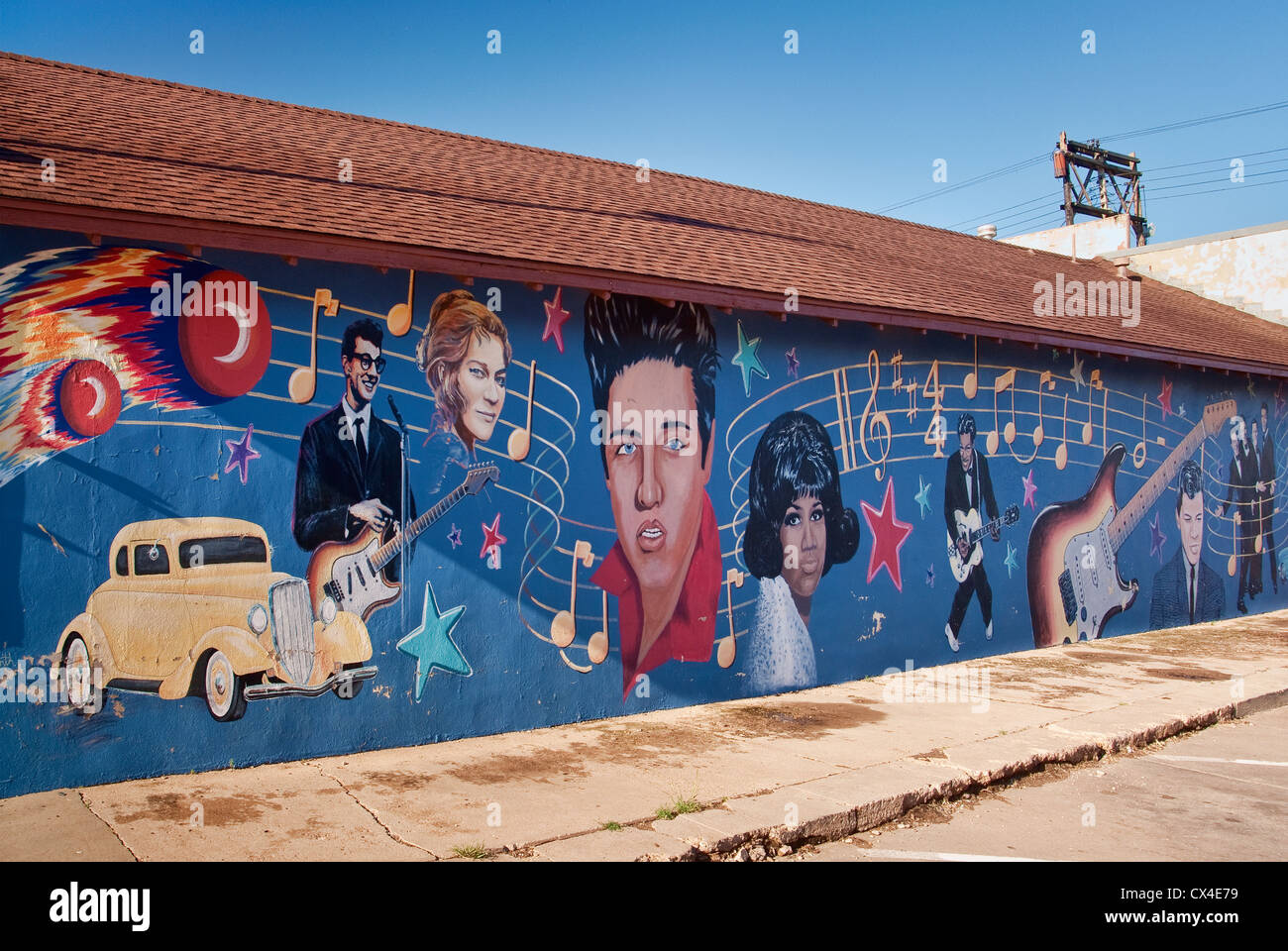 Elvis Presley, Buddy Holly, Aretha Franklin, Chuck Berry and other 1950's rock'n'roll stars in mural - Stock Image