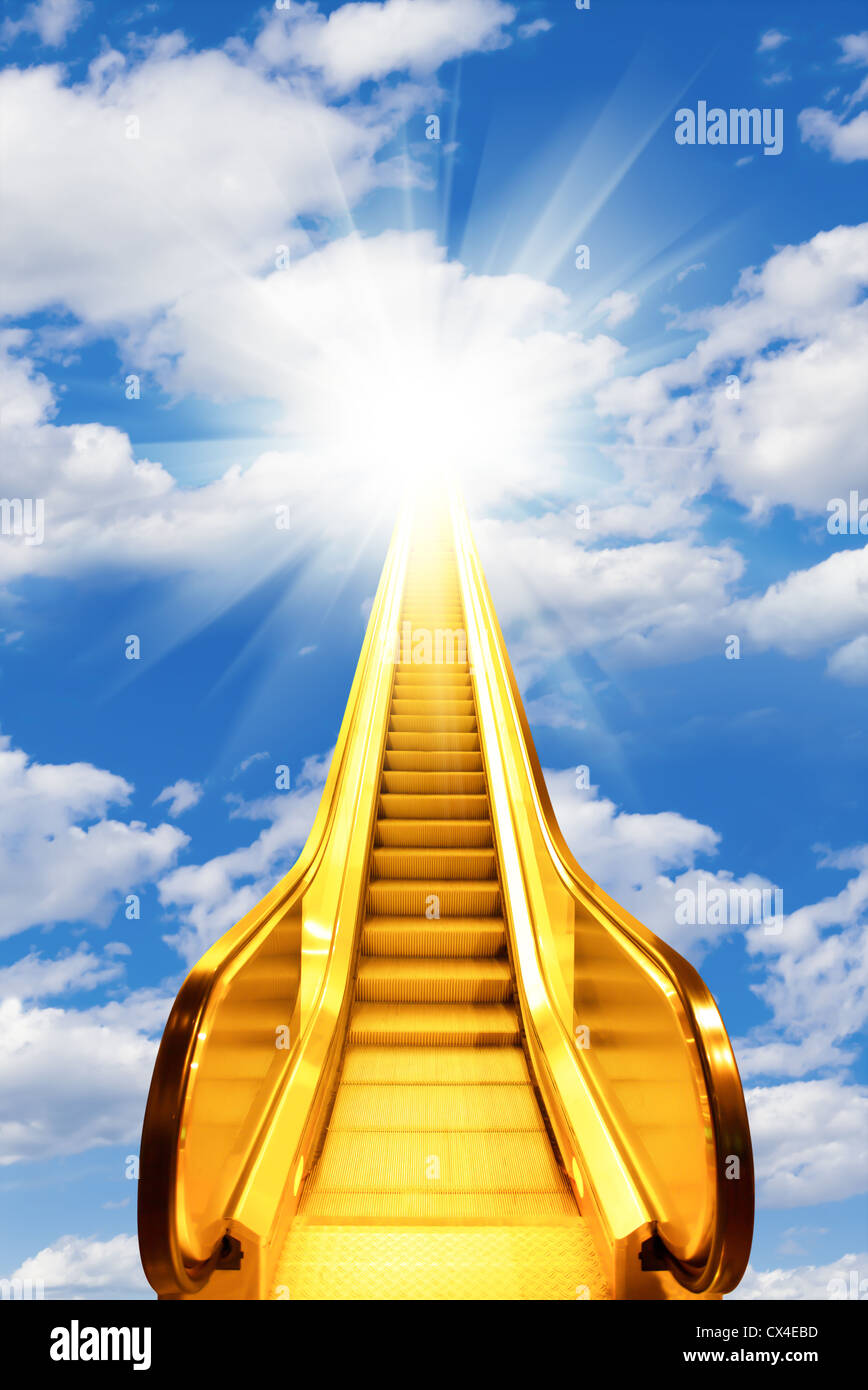 golden escalator stairs to the shine in the sky - Stock Image