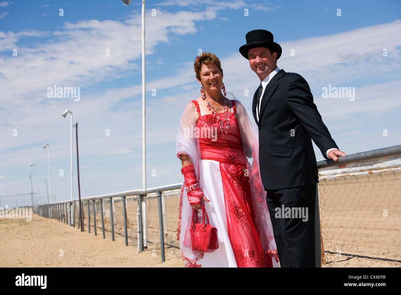 Couple in fancy dress for the fun of the Birdsville Races.  Birdsville, Queensland, AUSTRALIA. - Stock Image