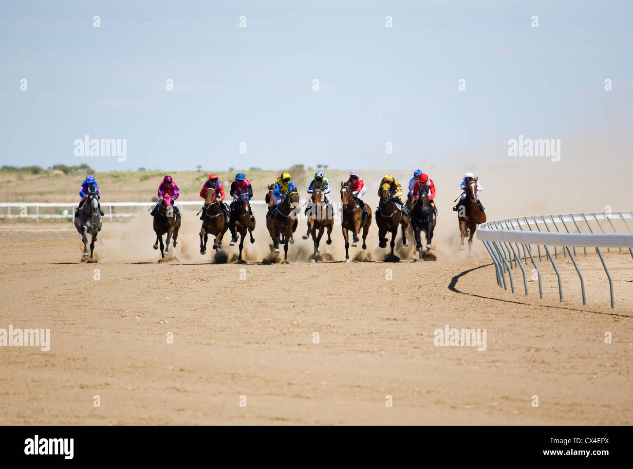 Horse racing in the outback at the Birdsville Cup races.  Birdsville, Queensland, AUSTRALIA. - Stock Image