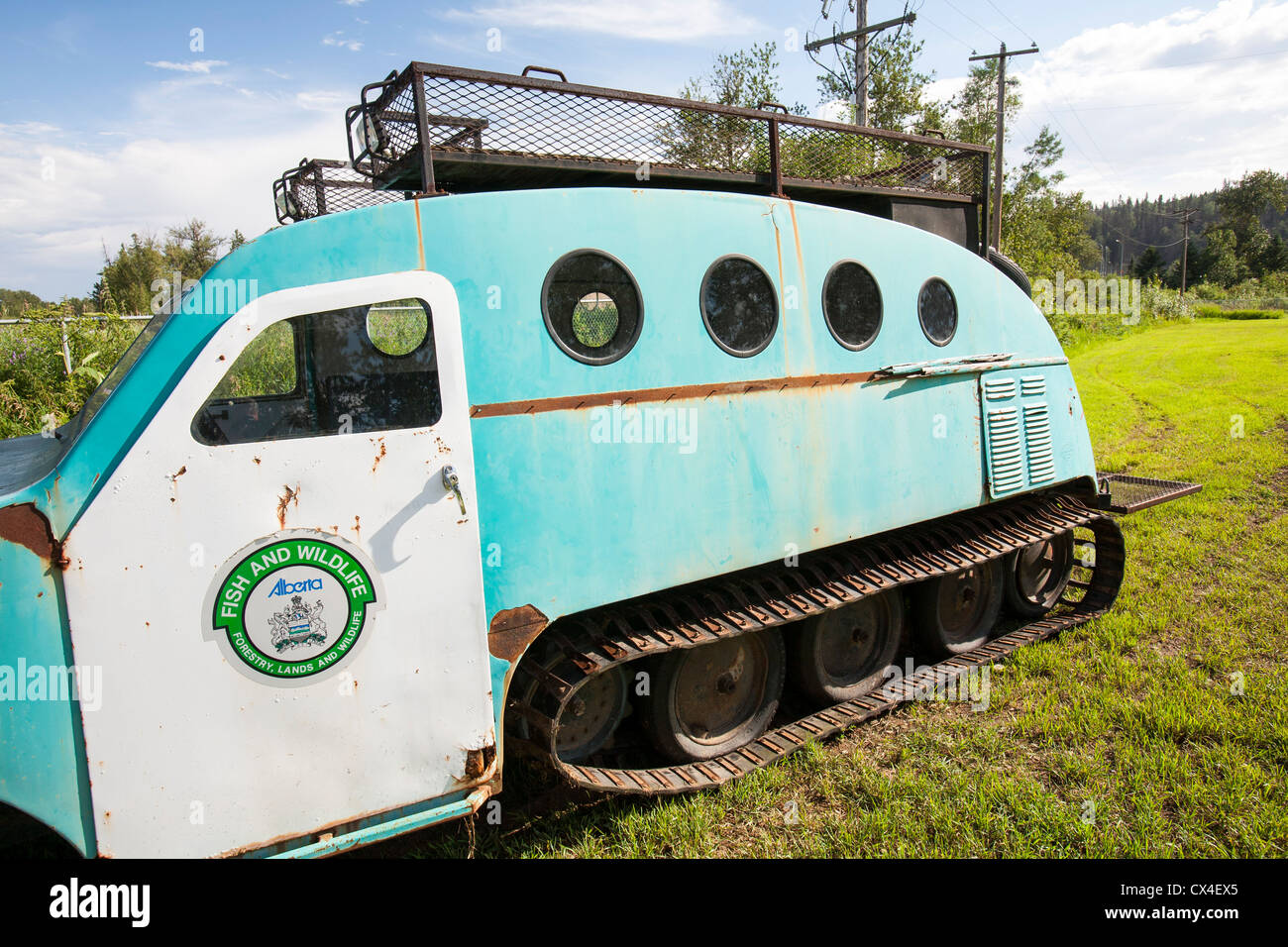An old preserved snow mobile in the museum in Fort McMurray, Alberta, Canada. - Stock Image
