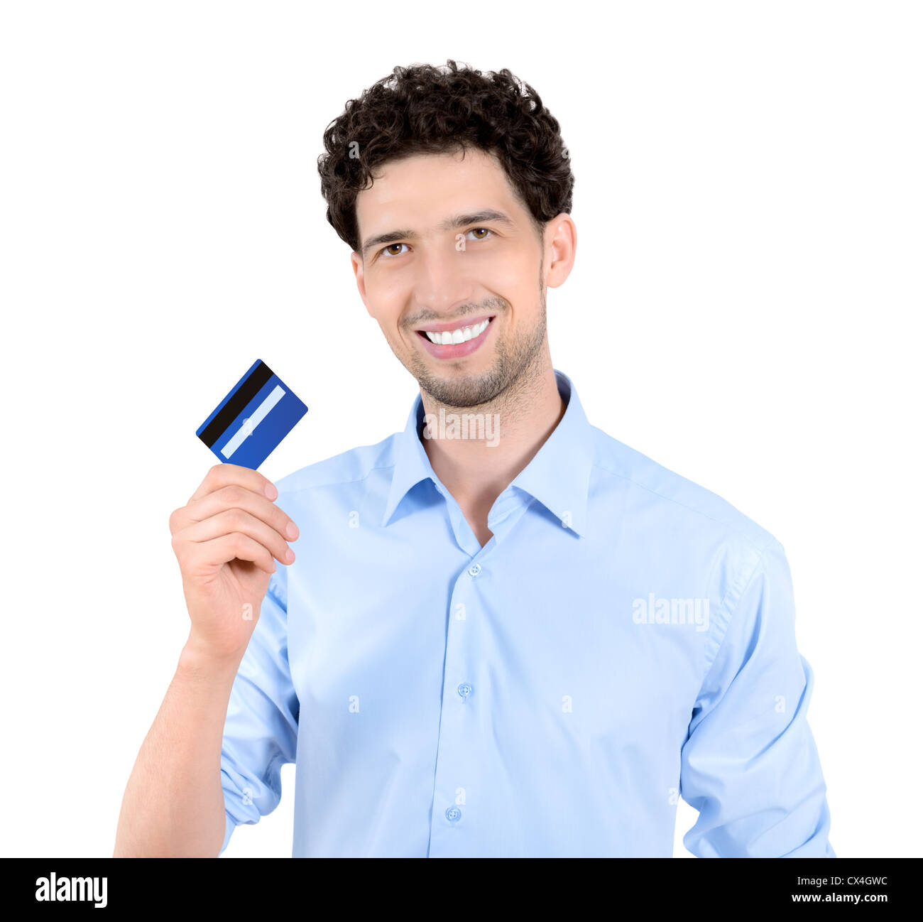 Young handsome man showing credit card. Isolated on white. - Stock Image
