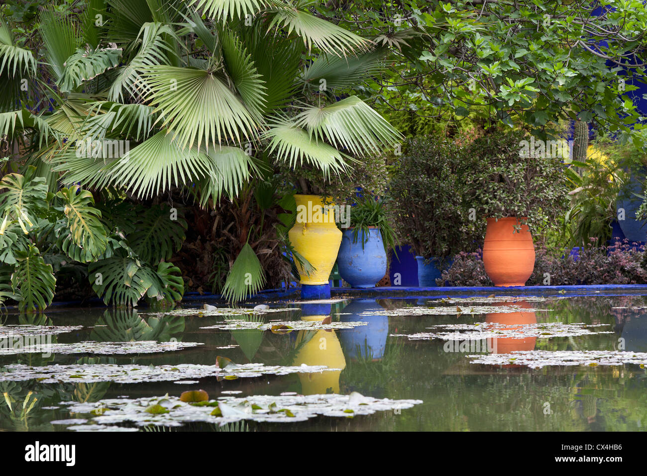 Marrakesh Morocco, April 1, 2012, Pond and flower pots in the Majorelle gardens - Stock Image