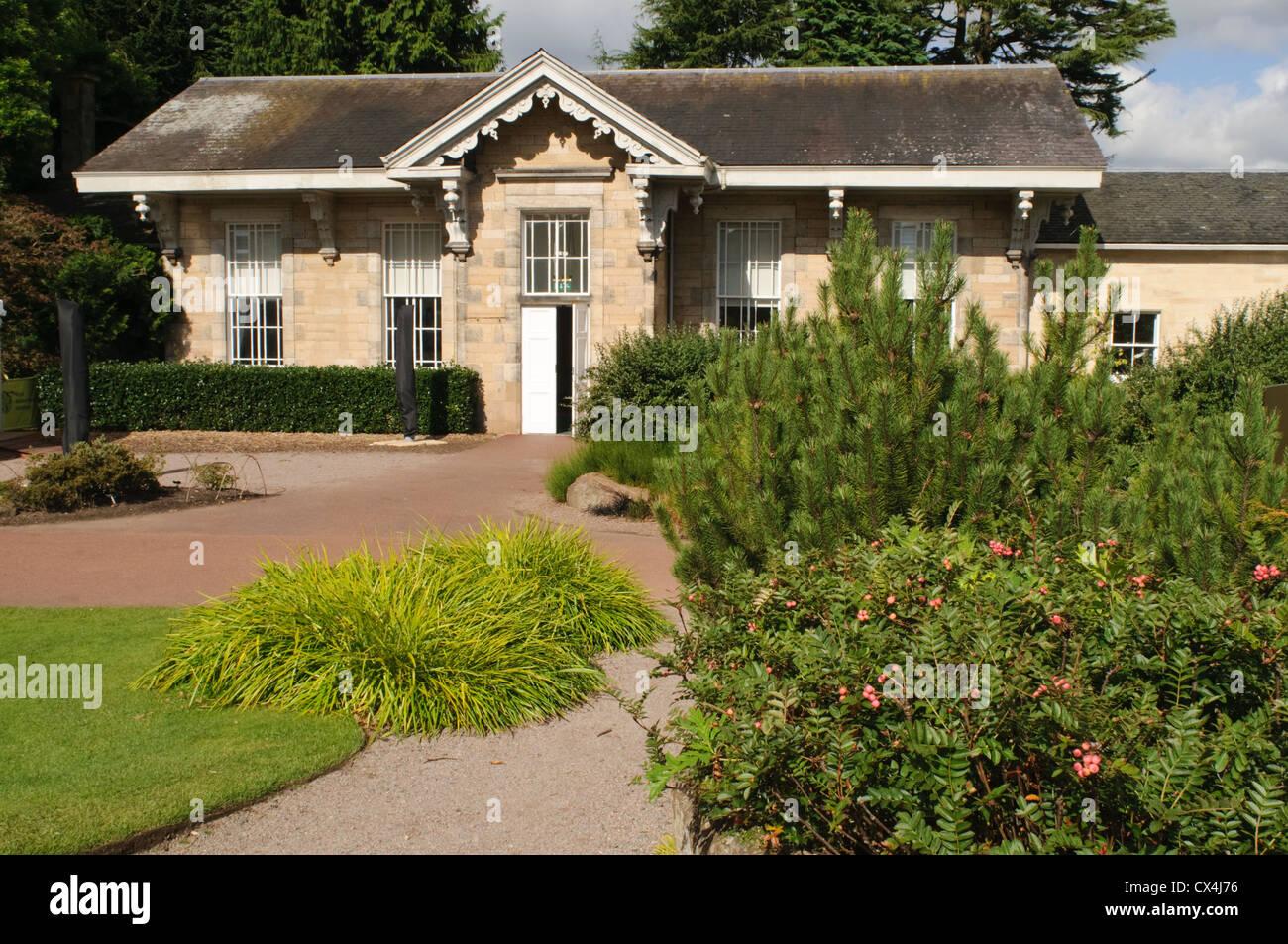 Royal Botanic Garden Edinburgh, The Caledonian Hall, viewed from the Rock Garden. - Stock Image