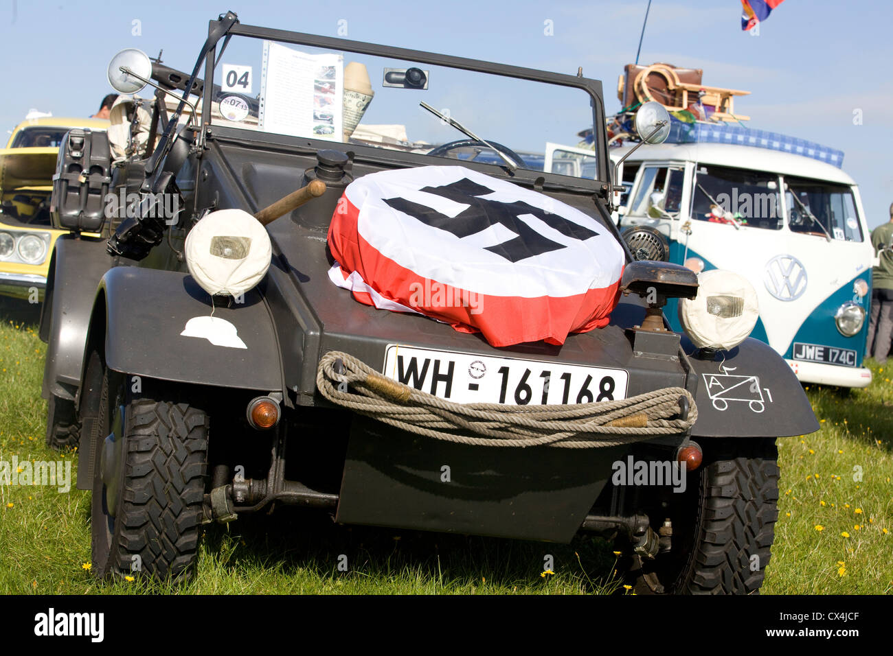 Red-white-black Swastika on the spare wheel of a German Built Jeep - Stock Image