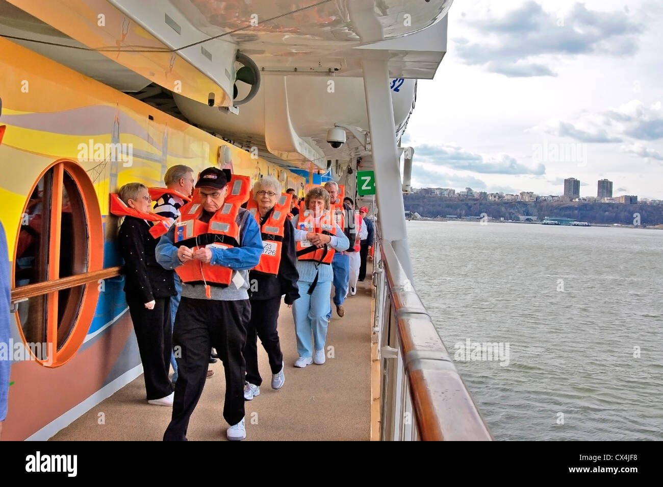For new passengers mandatory guest boat drill  of Norwegian Dawn Cruise Ship - Stock Image