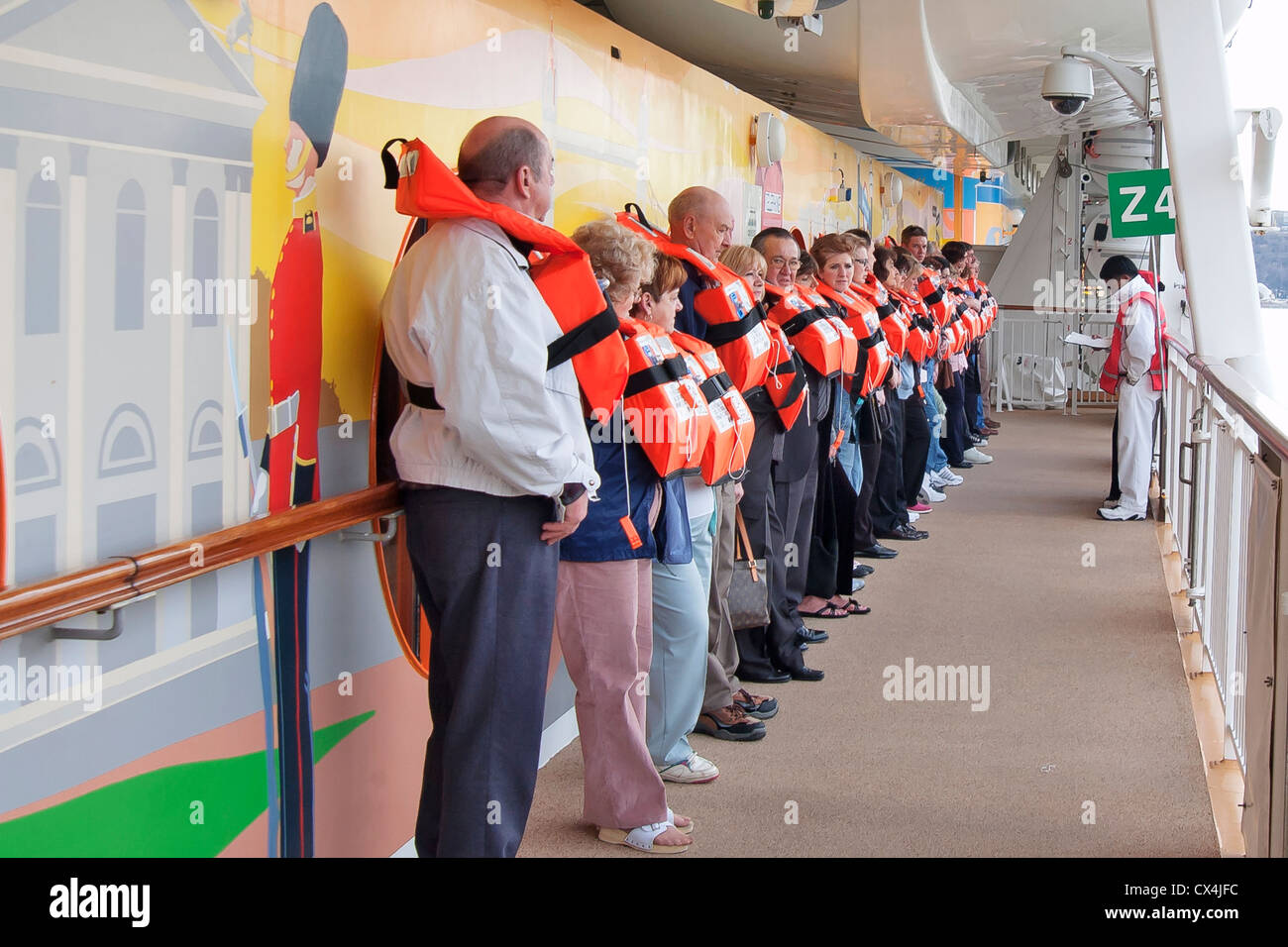 Mandatory guest boat drill for new passengers of Cruise Ship - Stock Image