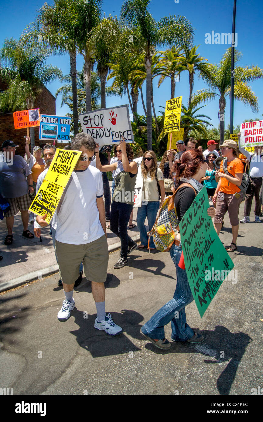 Angry but nonviolent  pickets march at Anaheim, CA, police headquarters to protest recent police shootings of local - Stock Image
