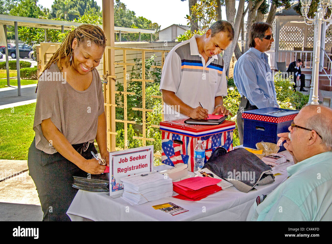 A smiling Africa-American woman registers at a job fair for military veterans in Santa Ana, CA. - Stock Image