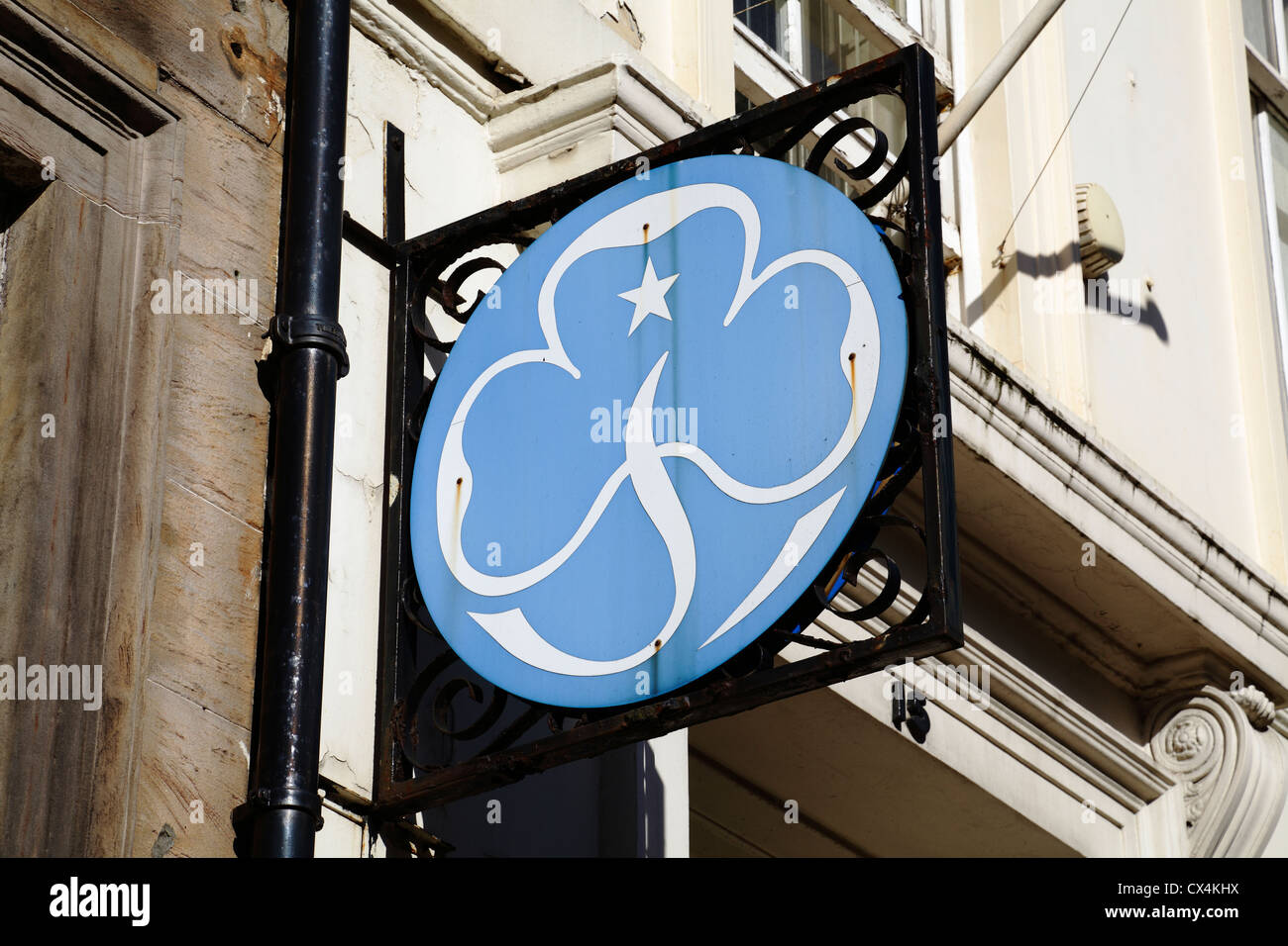 A sign outside a Girl Guide shop, UK - Stock Image