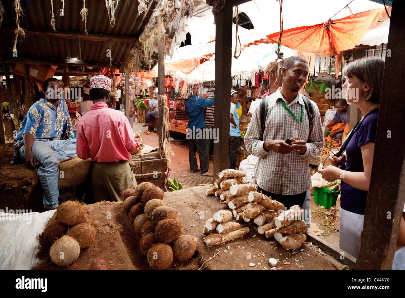 Tourists and local people shopping in the Darajani food market, Stone town, zanzibar africa - Stock Image