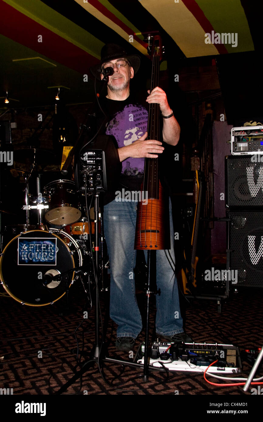 Doug Long of The After Hours Band playing the 2010 NS NXT 4 Upright bass guitar during the 2012 Dundee Blues Bonanza.UK Stock Photo