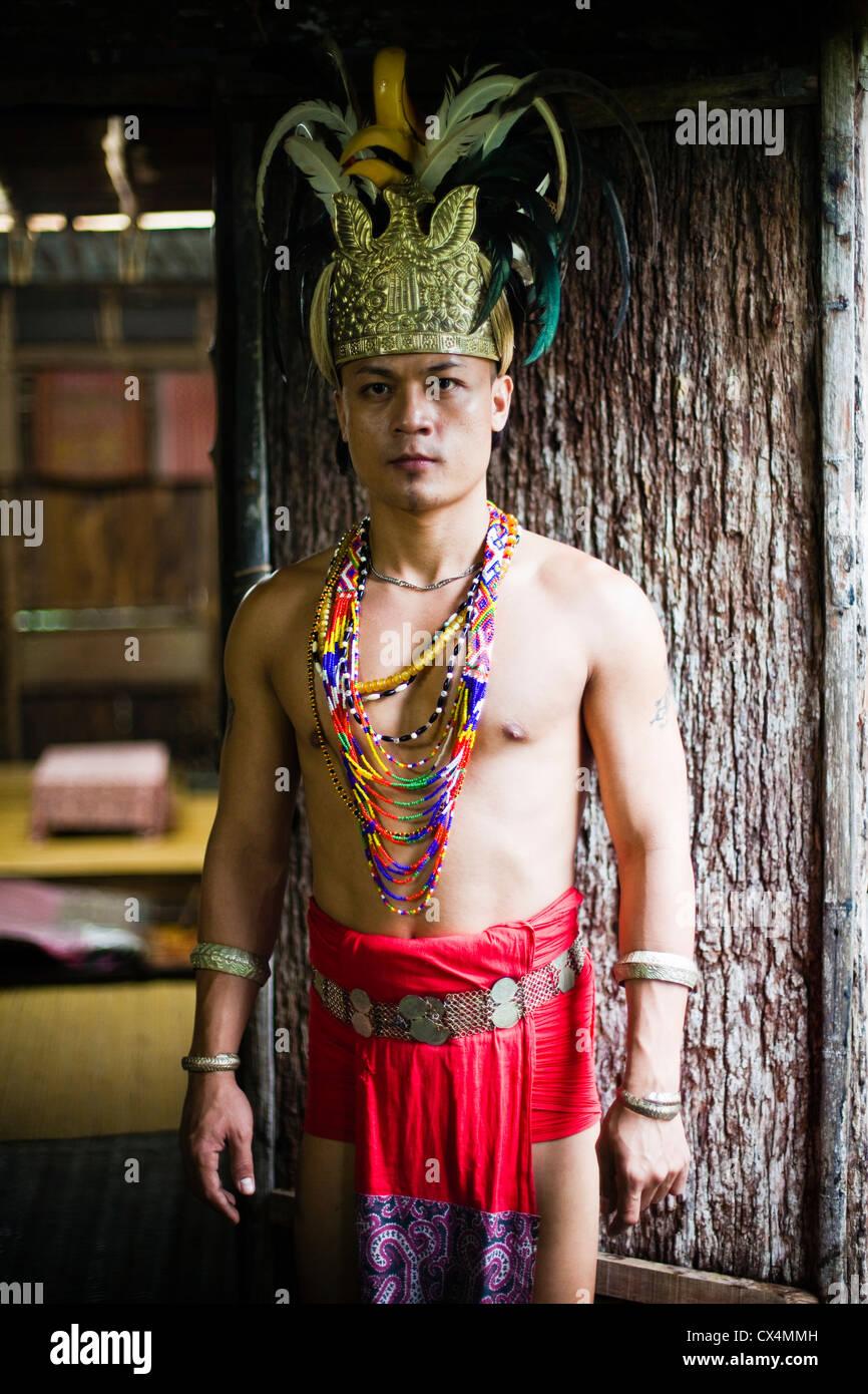Iban man in traditional dress at the Sarawak Cultural Village, Damai Beach. Kuching, Sarawak, Borneo, Malaysia - Stock Image
