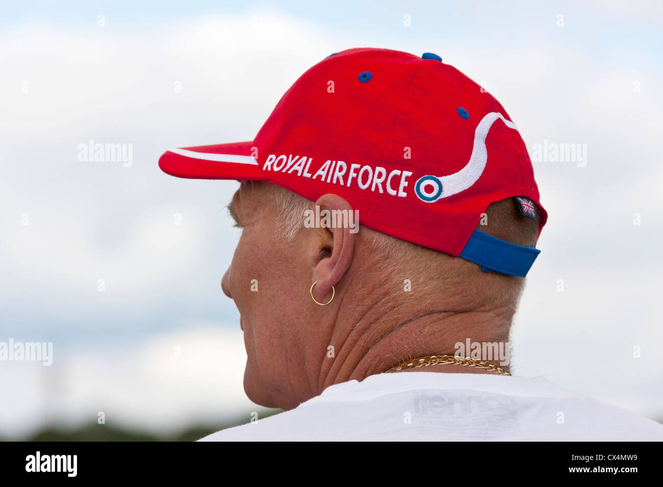 Man wearing Royal Air Force Red Arrows red hat at Best of British Show, Cotswold (Kemble EGBP) Airport. JMH6062 - Stock Image